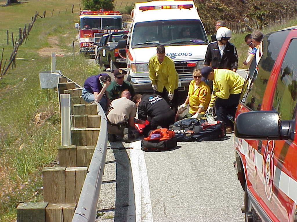 Emergency crews at work for a down bicycle.